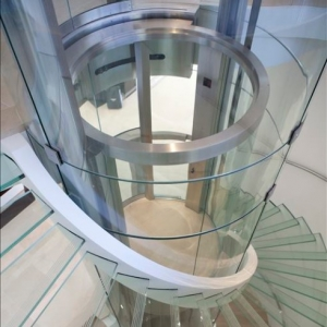 Good price 10mm super clear curve tempered glass elevator lifts wholesale