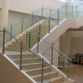 China Trapezoidal safety stair railing glass manufacturer, spiral stair railing curved glass supplier factory